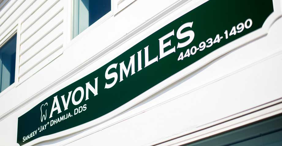 Avon Smiles Sign